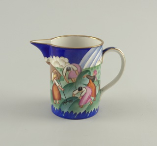Cylindrical in shape, with large projecting spout, loop handle; painted decoration of women and men farming around sides; colors predominantly deep blue, green, reds; thin gilt rim around top and handle.