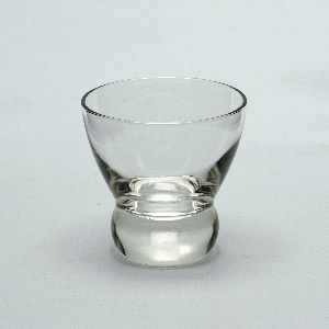Circular glass tapered at the bottom with thick donut-shaped base.