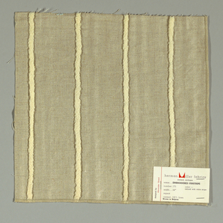 Plain weave in beige with applied stripe in white yarn. Yarn is looped and stitched to the surface of the plain weave.