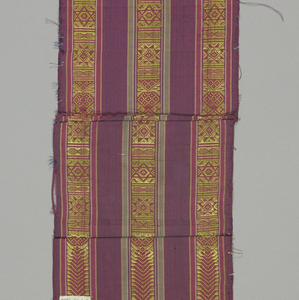 Silk pieces and border. Made of French 18th-century yellow ribbed silk brocaded with silks in serpentine floral design, trimmed with bands of silk striped maroon and red with yellow geometric figure.