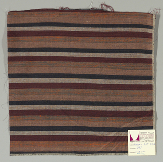 Weft-faced plain weave with doubled wefts in uneven horizontal stripes of light brown, black, grey/tan mixed, maroon, and orange / grey mixed. Warp is comprised of very fine black threads. Number 398.