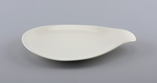 White teardrop shaped form with everted handle.