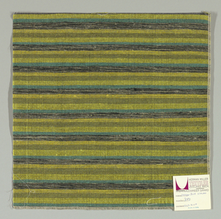 Weft-faced plain weave with doubled wefts in uneven horizontal stripes of green, yellow, olive green and black / grey mixed. Warp is comprised of very fine black threads. Number 393.