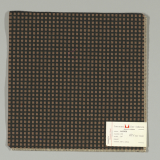 Warp-faced plain weave in black with small brown squares. Brown squares are formed by supplementary weft floats.