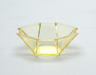 Yellow glass octogon shaped bowl