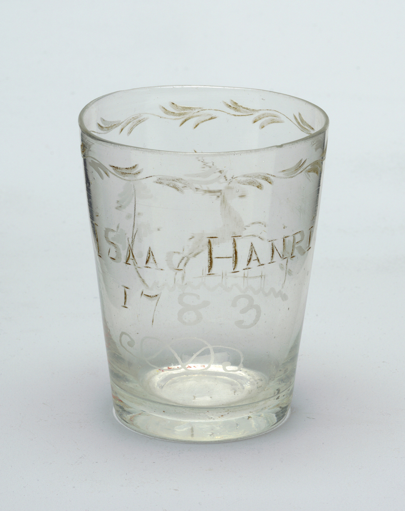 "Clear glass beaker.  ""Isaac Hanri"" etched or engraved on body"