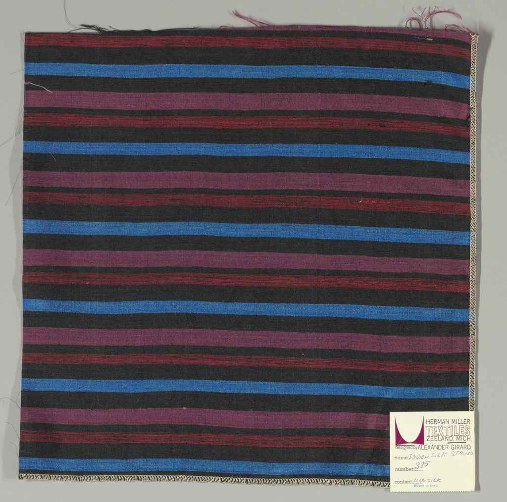 Weft-faced plain weave with doubled wefts in uneven horizontal stripes of black, blue, violet and red/black mixed. Warp is comprised of very fine black threads. Number 385.