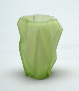 Upright form with thick, angular glass walls in transluscent shade of yellow-gold.