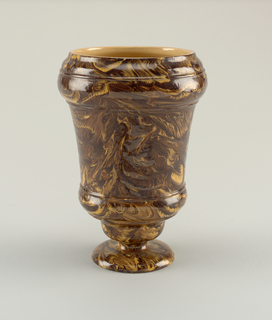 Vase with footed base, made of scroddled ware- mixed color clay to resemble marble.