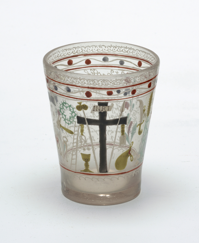 Clear glass beaker with slight gray cast.  Painted decoration.  Large cross central figure.