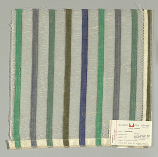 Vertical bands of plain weave in green, grey, dark green, olive green and dark blue are joined together by long off-white weft floats. Bands give a stripe effect. Number 426.