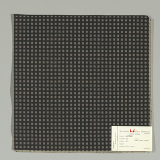 Warp-faced plain weave in black with small grey squares. Grey squares are formed by supplementary weft floats.