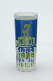 "Tall, slightly tapering cylindrical form of clear ""frosted"" glass with blue and green enamel decoration showing the New York State Exhibit, ""1964/1965/NEW YORK/WORLD'S FAIR,"" and Unisphere logo; green panel with brief paragraph about the Exhibit on reverse."