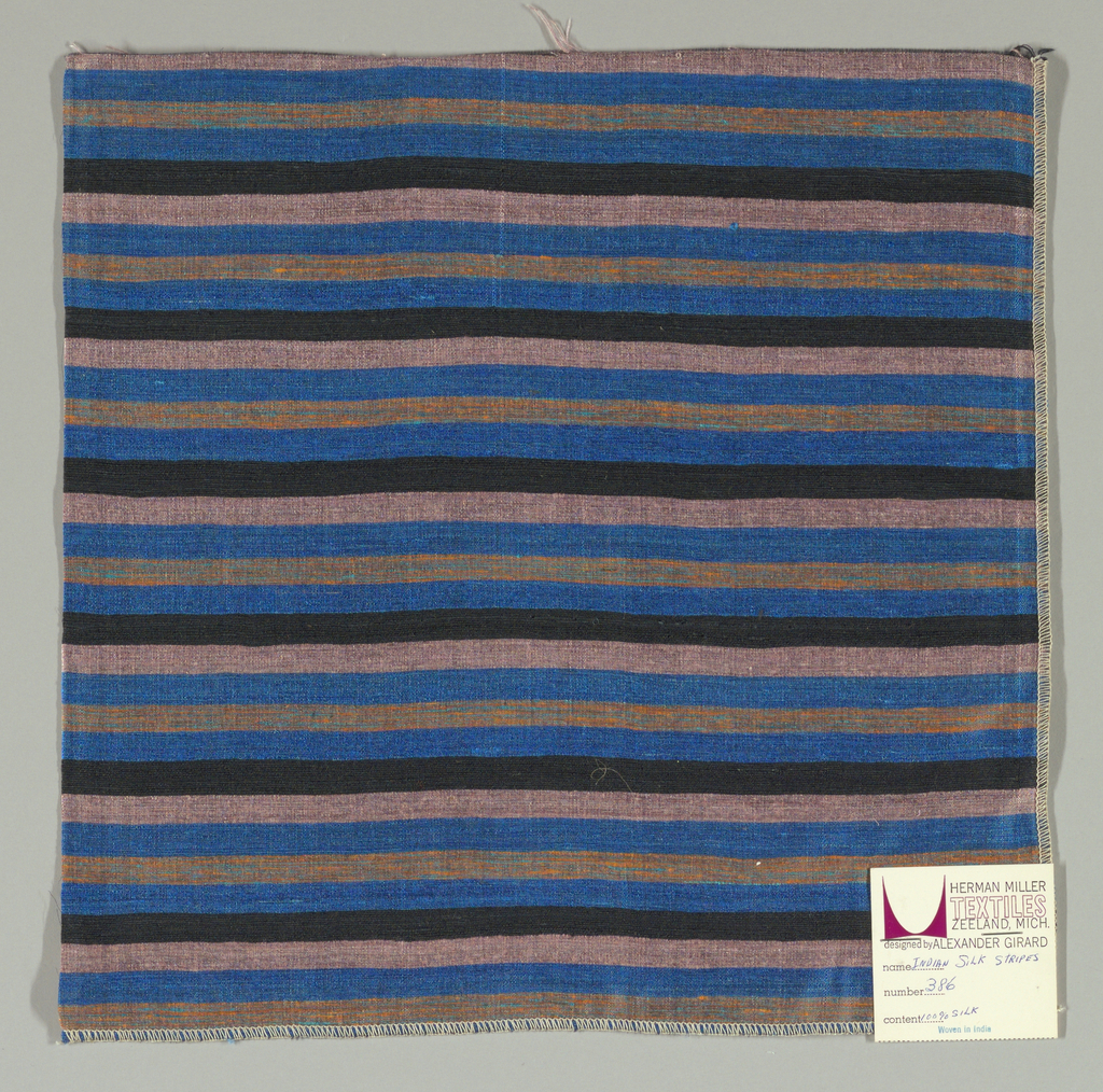 Weft-faced plain weave with doubled wefts in uneven horizontal stripes of blue, black, pink, and orange/turquoise mixed. Warp is comprised of very fine black threads. Number 386.