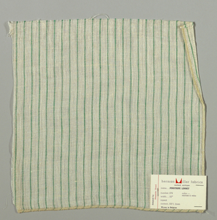 Plain weave in white with thin vertical green stripes. Warp threads are white and green and weft threads are white. Slightly loose weave structure. Number 674.