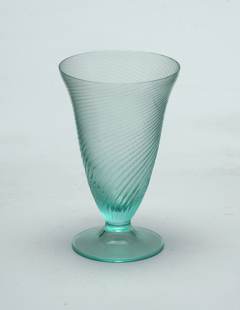 Bottle-green glass with flared lip, swirling ribbed pattern