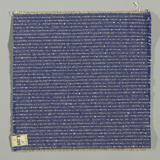 Plain weave in dark blue with horizontal white stripes. Warp is comprised of thin light brown threads. Weft is comprised of dark blue and white boucle yarn.