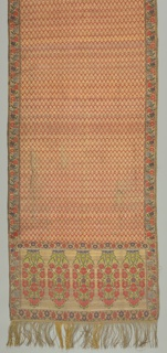 Panel woven entirely with gold threads and additional colors of red, purple and green showing an allover geometric tree pattern. Border, parallel to selvage, has flowers. Both ends of the panel setoff by a wide border showing floral groups. Gold fringe.