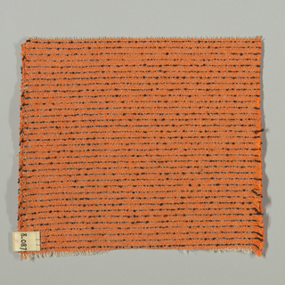 Plain weave in orange with horizontal black stripes. Warp is comprised of thin light brown threads. Weft is comprised of orange and black boucle yarn.