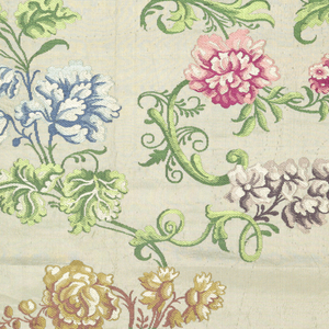Fragment of brocaded silk with large-scale floral sprays and foliage in colored silks on a white ground.