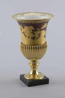 A Triumph of Neptune and Solatea vase with a square platform bottom. Goblet like shape with a flared lip in  yellow, orangle and red.