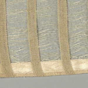 Vertical bands of plain weave in beige are joined together by long off-white weft floats. Bands give a stripe effect. Number 428.