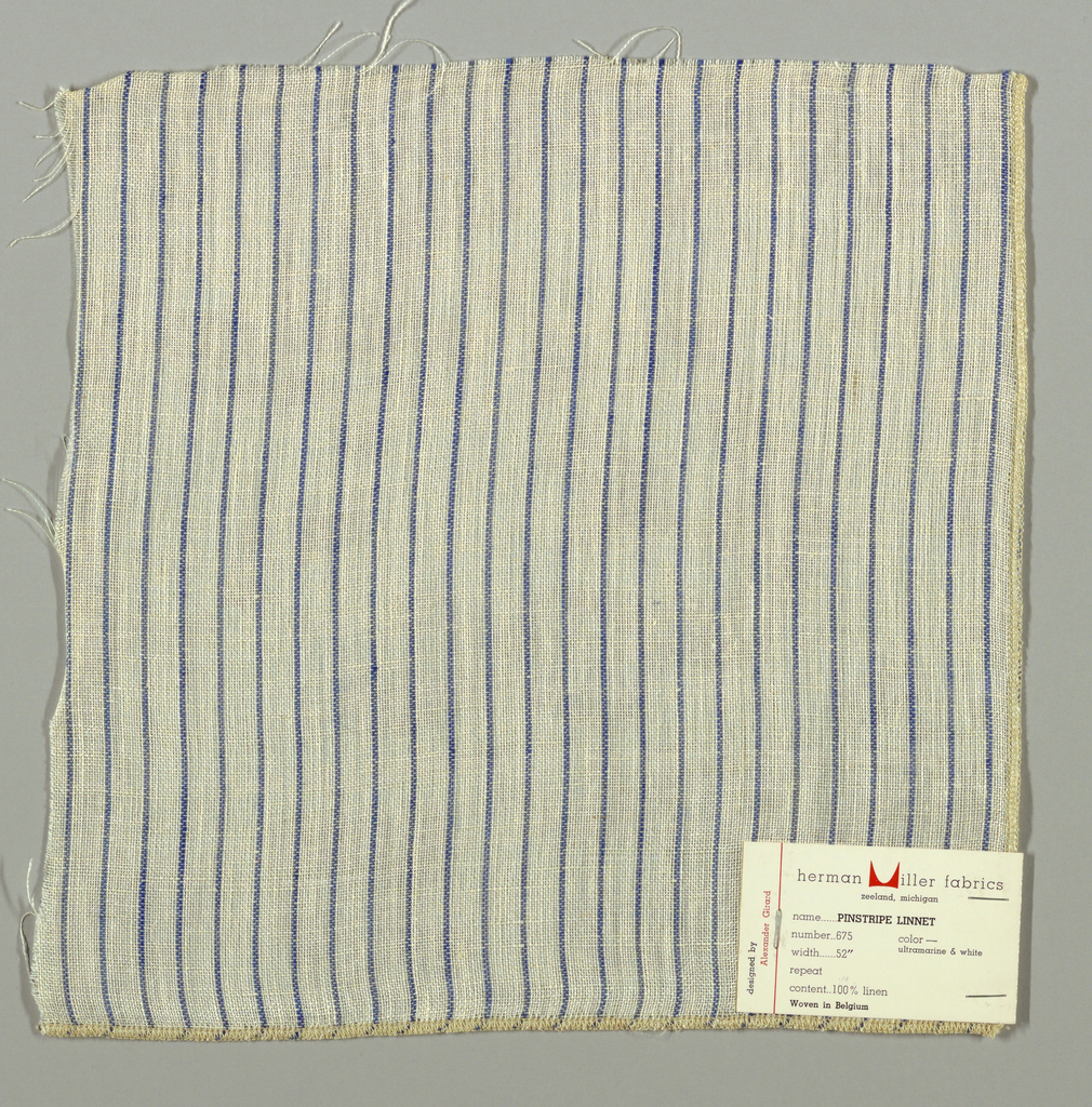 Plain weave in white with thin vertical blue stripes. Warp threads are white and blue and weft threads are white. Slightly loose weave structure. Number 675.