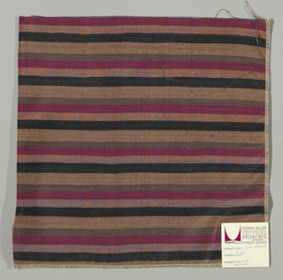 Weft-faced plain weave with doubled wefts in uneven horizontal stripes of black, light brown, brown, magenta and orange/blue mixed. Warp is comprised of very fine black threads. Number 388.