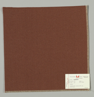 Plain weave with doubled warps and wefts in red-brown. Weave structure adds a subtle surface texture. Number 279.
