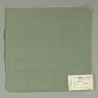 Plain weave in pale green. Warp is comprised of fine white threads while the weft has heavier pale green yarns.