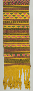 Sash of yellow handwoven cotton with pattern brocaded in horizontal direction in bars of geometric design; patterns show great variety. Colors: dark red, dark green, black and bright pink. Long fringe from the warp.