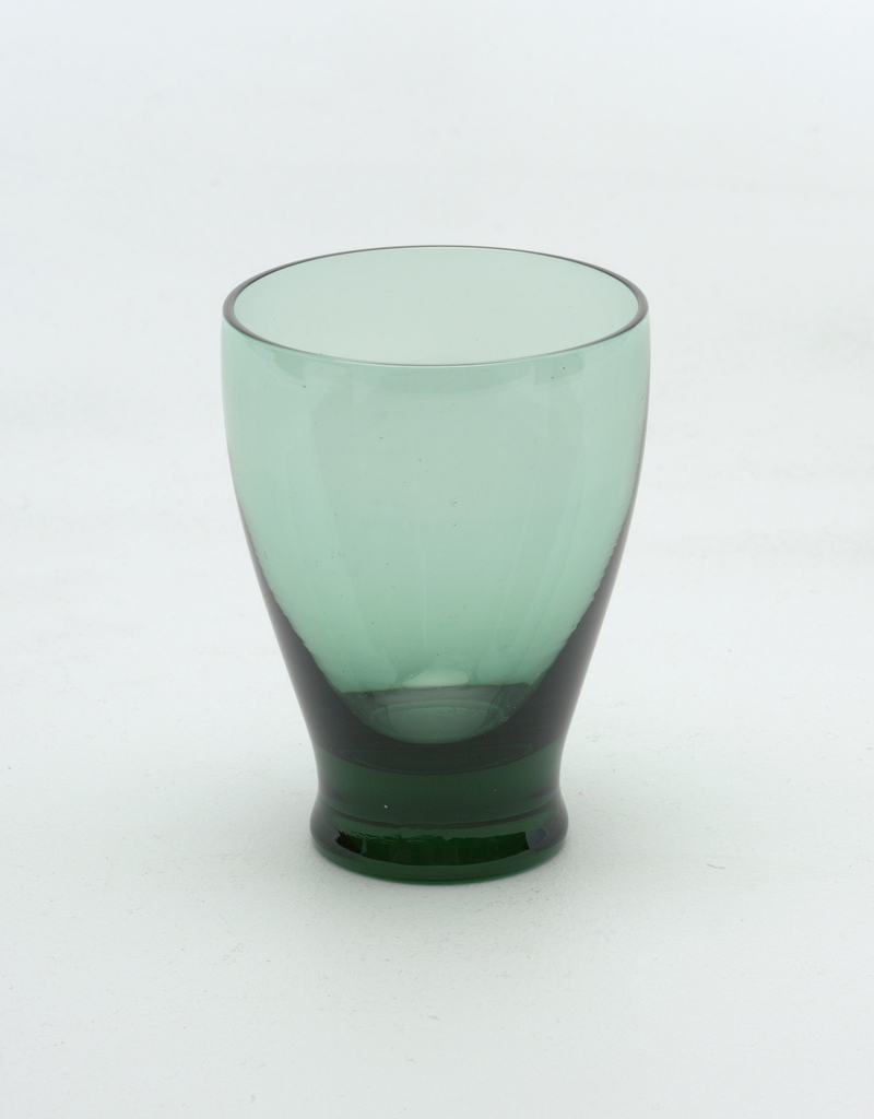 """Glassware in """"Seafoam"""" color consisting of a) water goblet, b) cocktail glass, c) tumbler, d) dessert bowl."""
