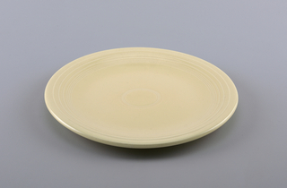 Yellow ceramic platter.
