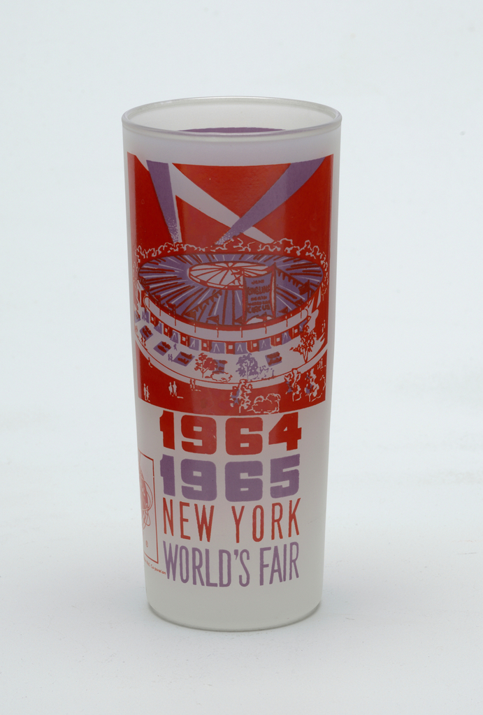 """Tall, slightly tapering cylindrical form of clear """"frosted"""" glass with violet and orange enamel decoration showing the World's Fair Circus, """"1964/1965/NEW YORK/WORLD'S FAIR,"""" and Unisphere logo; violet panel with brief paragraph about the circus on reverse."""