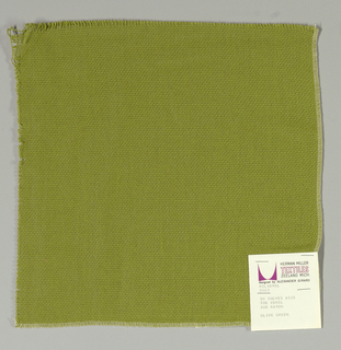 Plain weave in olive green. Slightly loose weave structure. Number 2023.