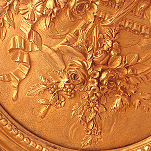 Medallion in frame.  Trophy composed of birds and flowers, with musical instruments.