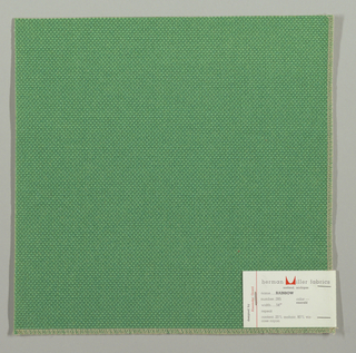 Plain weave with doubled warps and wefts in green. Weave structure adds a subtle surface texture. Number 285.