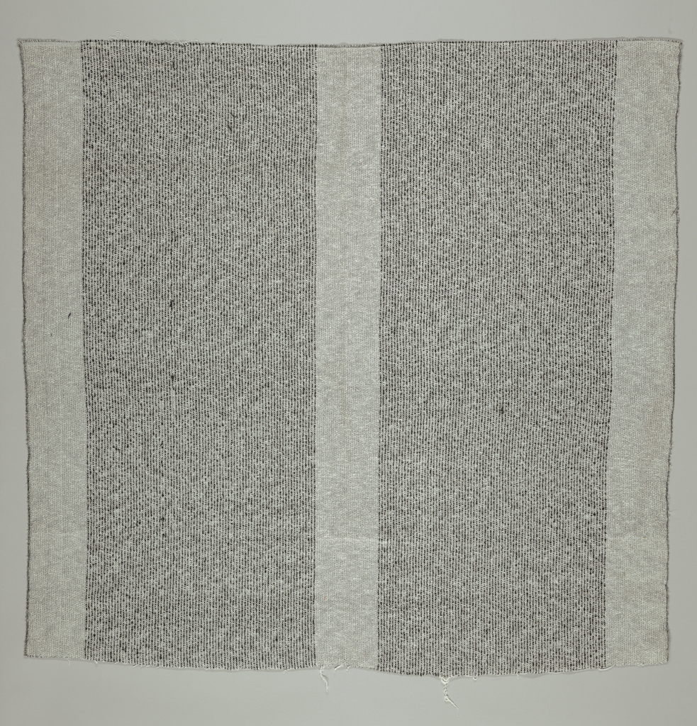 Handwoven material for a jacket in black and white.