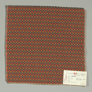 Pattern of small checks in red, orange, black and brown. Warp threads are black and white and weft threads are white with supplementary weft in red, orange and brown.