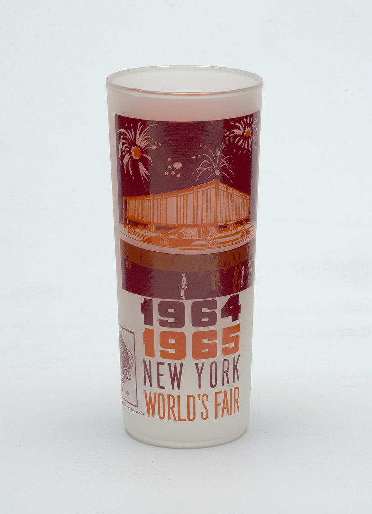 """Tall, slightly tapering cylindrical form of clear """"frosted"""" glass with crimson and orange enamel decoration showing the Federal Pavilion, """"1964/1965/NEW YORK/WORLD'S FAIR,"""" and Unisphere logo; orange panel with brief paragraph about the Pavilion on reverse."""