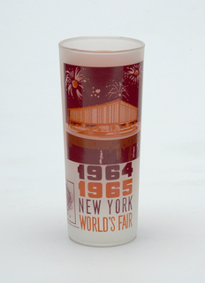 "Tall, slightly tapering cylindrical form of clear ""frosted"" glass with crimson and orange enamel decoration showing the Federal Pavilion, ""1964/1965/NEW YORK/WORLD'S FAIR,"" and Unisphere logo; orange panel with brief paragraph about the Pavilion on reverse."
