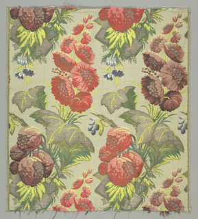 Polychrome silk brocade with silver metallic. Large red and and violet flowers with silvery leaves grownig from rocky mounds.