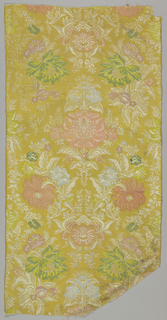 Fragment of silk brocade with an orange ground with a minute tulip pattern forming a diaper in the background. The main, symmetrical floral pattern is brocaded in pale shades of blue, green, red, white, and gold.