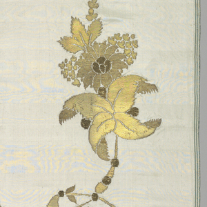Length of white silk brocaded with three types of gold metallic yarns, with large C-shaped curves and exotic leaves and flowers.