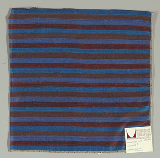 Weft-faced plain weave with doubled wefts in uneven horizontal stripes of turquoise, brown, blue and red/black mixed. Warp is comprised of very fine black threads. Number 387.