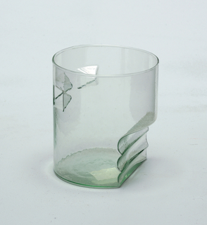Bottle green glass.  Decorated with three vertical pyramid-shaped piercing at top and three horizontal semi-circular ridges at bottoms fitted for finger placement