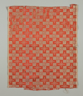 Dark orange and silver fabric with an allover pattern of crosses containing Christian symbols and Greek lettering.