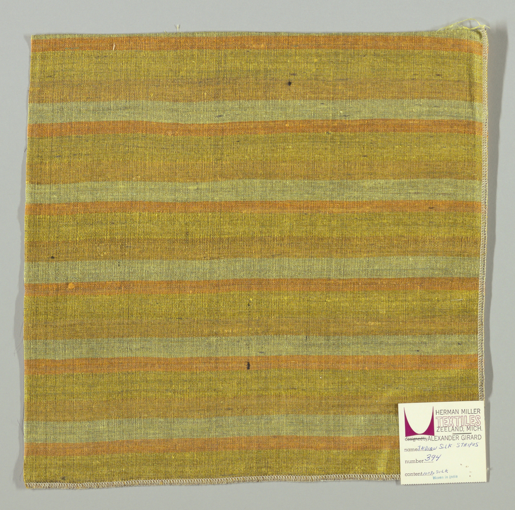 Weft-faced plain weave with doubled wefts in uneven horizontal stripes of orange, pale yellow and dark yellow. Warp is comprised of very fine black threads. Number 394.