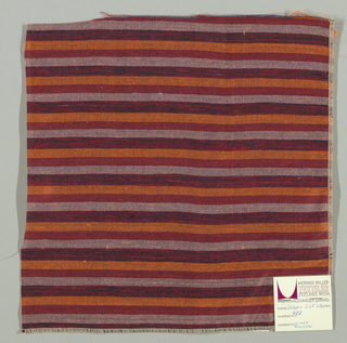Weft-faced plain weave with doubled wefts in uneven horizontal stripes of orange, red, pink and red/black mixed. Warp is comprised of very fine black threads. Number 383.