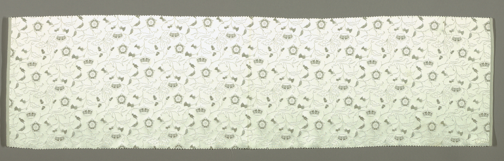 White satin ground with delicate allover design of oak and thistle sprays, English lion, Tudor rose, crown; in cotton and silk weft floats in various plain and fancy twills. Two wide weft-ribbed selvages in plain cloth with grouped wefts. Woven for the coronation of Queen Elizabeth II.
